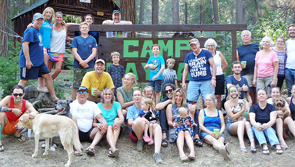 Guests and Camp Layman sign